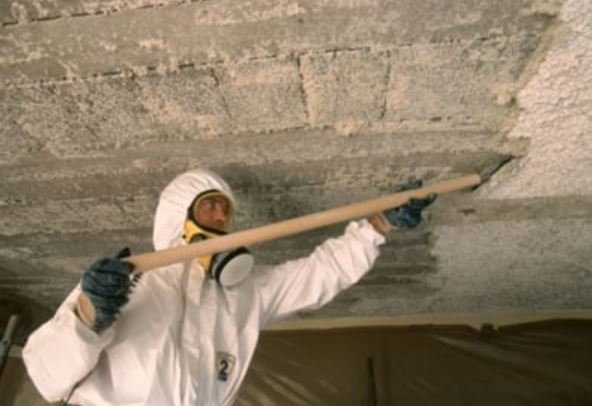 Asbestos removal on popcorn ceiling.